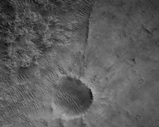 A raw image of the Martian surface below the Perseverance rover captured on Feb. 24, 2021, the fourth day of the mission.