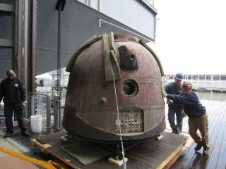 Workers at New York City's Intrepid Sea, Air and Space Museum wheel the Soyuz TMA-6 spacecraft into the museum on Oct. 18, 2011. The capsule is on loan and will become the latest addition to the Intrepid's outer space exhibit.