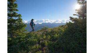 A woman hiking on Vail mountain