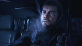 Chris Redfield sits in a car and smokes a cigarette