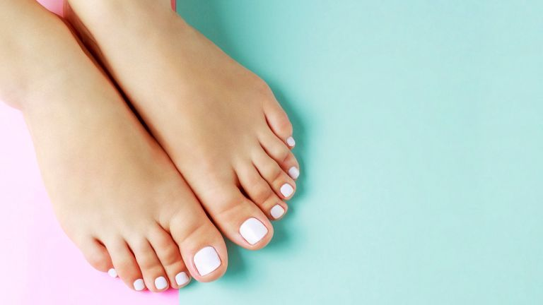 toes on pastel background