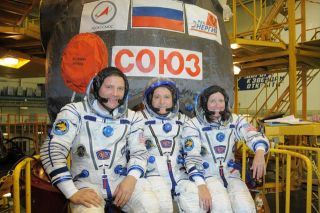 Picture of EXP 24 crew, 3 astronauts suited up