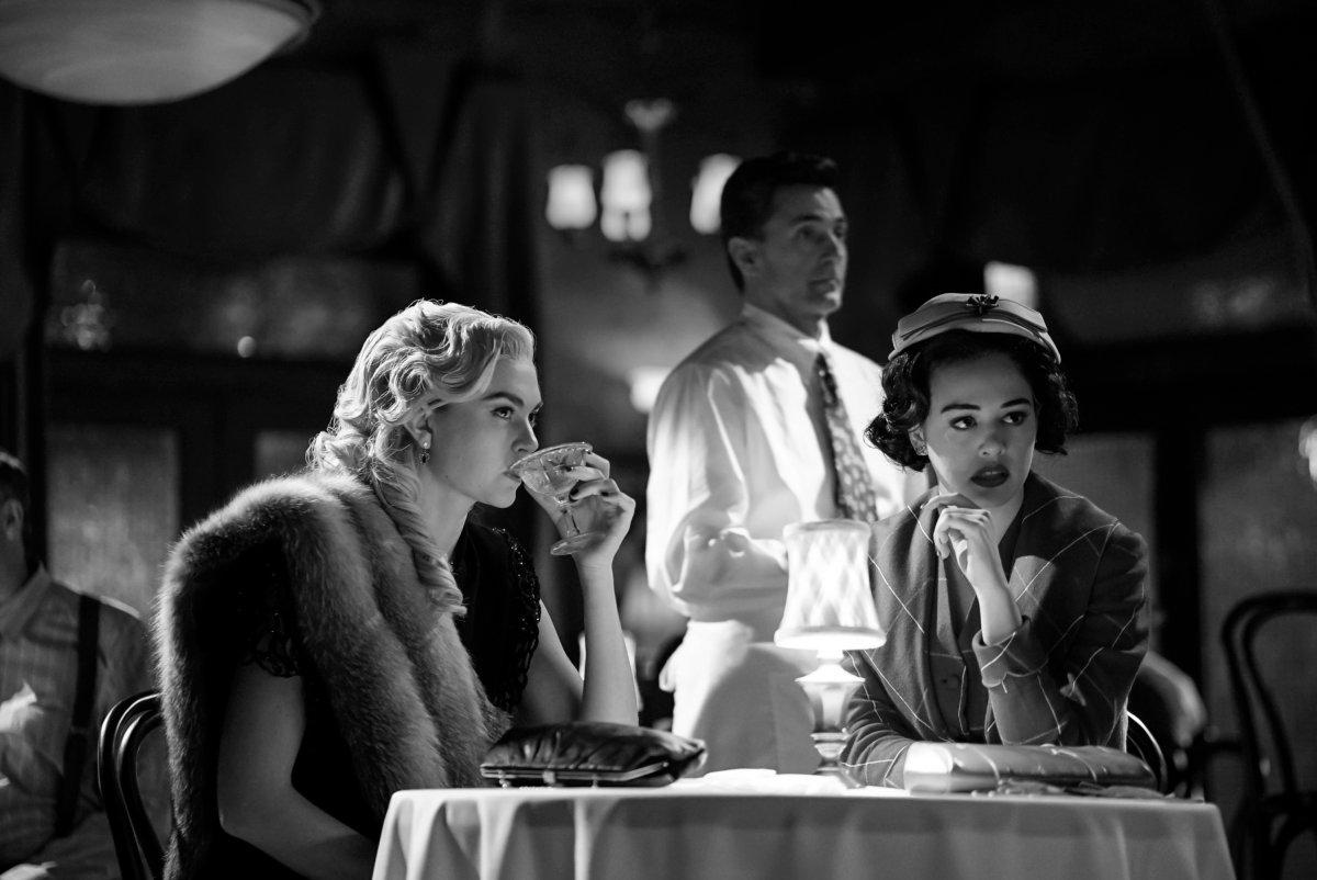 Legacies Season 2, Episode 14 The CW Lizzie and Josie film noir table