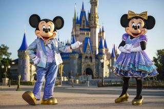 "Beginning Oct. 1, 2021, Mickey Mouse and Minnie Mouse will host ""The World's Most Magical Celebration"" honoring Walt Disney World Resort's 50th anniversary in Lake Buena Vista, Fla. They will dress in sparkling new looks custom made for the 18-month event, highlighted by embroidered impressions of Cinderella Castle on multi-toned, EARidescent fabric punctuated with pops of gold."