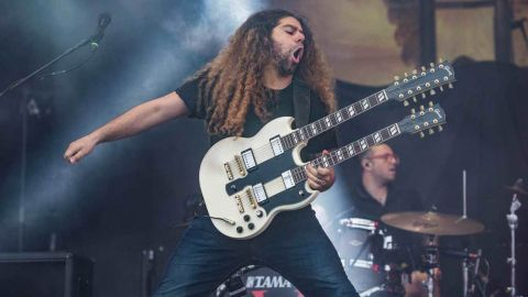 Claudio Sanchez from Coheed And Cambria playing his double neck guitar on stage