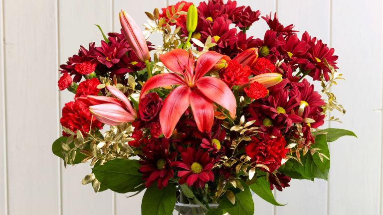 Christmas flower delivery: Red Mistletoe bouquet from Serenata Flowers