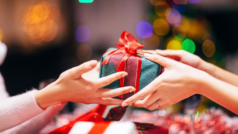 exchanging of christmas gift by getty images
