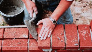 Builder Layer Brick Wall Using Mortar Mix