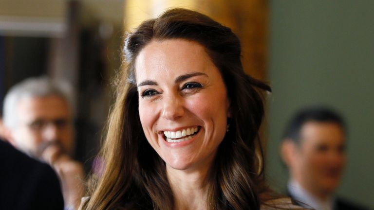 Catherine, Duchess of Cambridge laughs as she speaks with guests during a reception in support of The Anna Freud Centre on May 4, 2016 at Spencer House in London, England