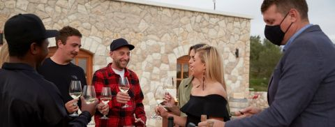 The crew gathers at a winery to celebrate ahead of the final charter of the season.
