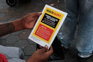 A few years ago, a person in New York City reads a flyer on the dangers of Fentanyl.