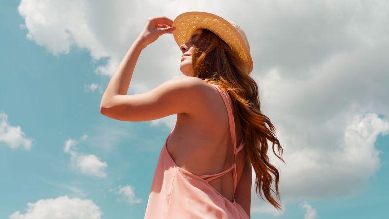 redheaded woman enjoying sunlight during summer solstice