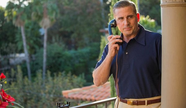 Steve Carell answering a call dapperly