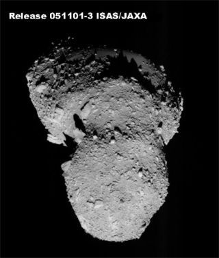 Japan's Hayabusa spacecraft prepares for touchdown on the Itokawa asteroid.