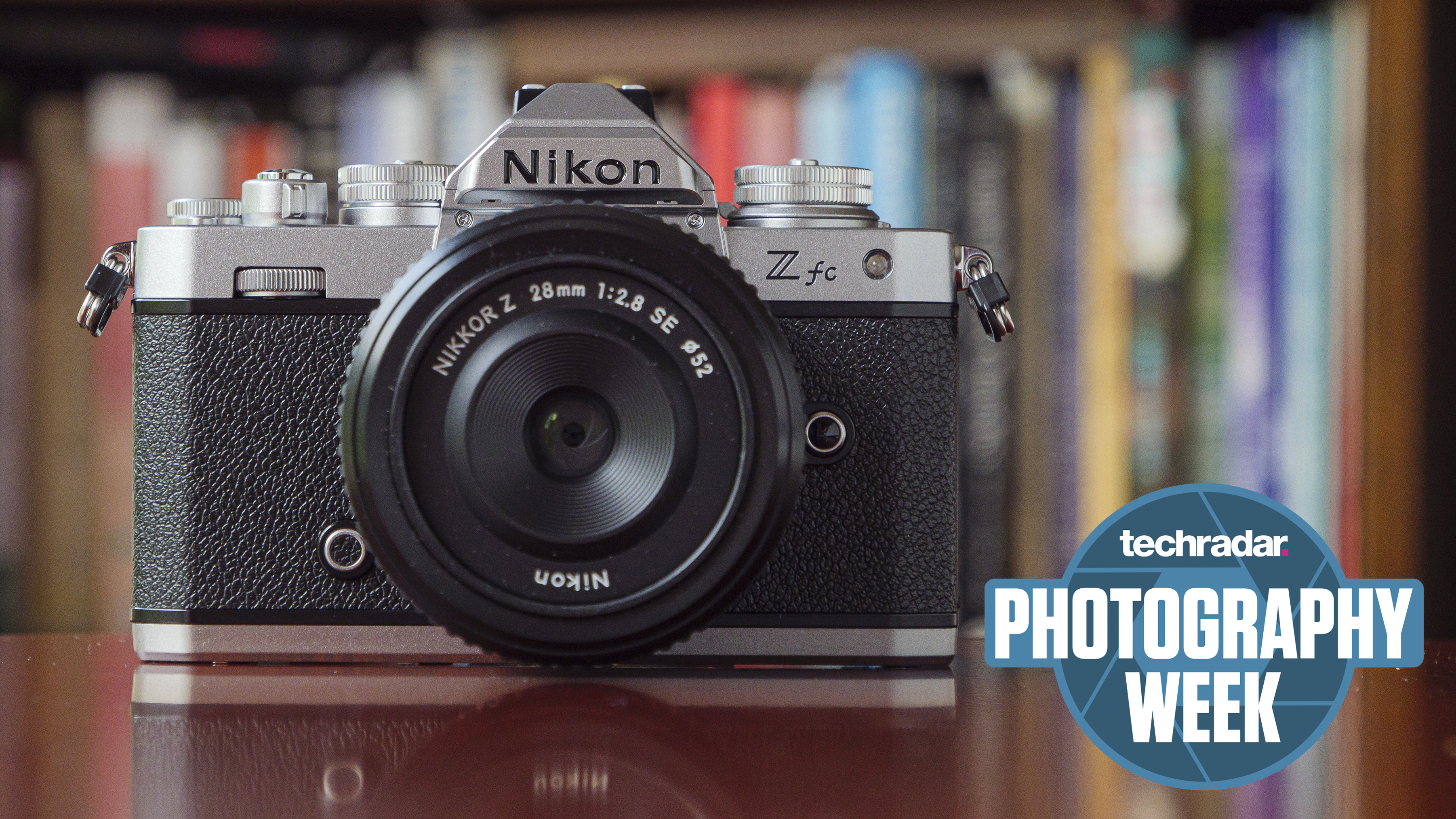 The Nikon Zfc mirrorless camera on a table in front of a bookcase