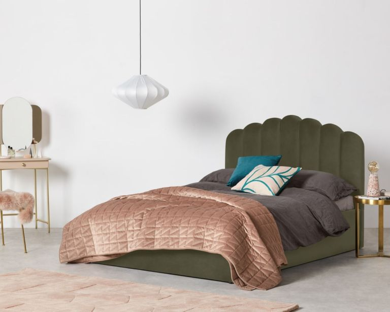 MADE.com Delia King Size Ottoman Storage Bed in green dressed inside a bedroom with grey bedding and pink decor