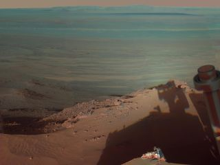 Opportunity Rover snaps shot of its own shadow and Endeavour Crater