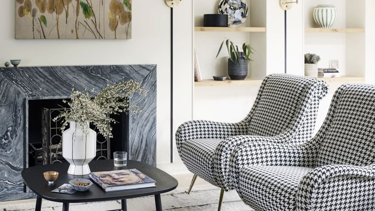 living room with black and white houndstooth check mid century armchairs in Victorian mews house in London with contemporary interior designed by Kitesgrove