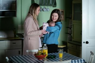 EastEnders Louise Mitchell and Bex Fowler with baby Peggy Mitchell