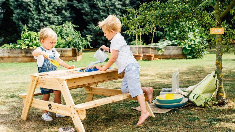 how to design a child friendly garden: plum play sand bench