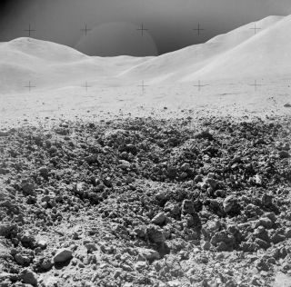 """A close-up view of a portion of a """"relatively fresh"""" crater, photographed by the Apollo 15 mission during a lunar surface extravehicular activity (EVA) on Aug. 2, 1971, near Scarp Crater."""