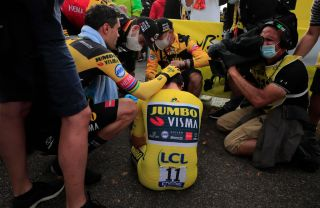 Team Jumbo-Visma rider Slovenias Primoz Roglic wearing the overall leaders yellow jersey down rests after crossing the finish line at the end of the 20th stage of the 107th edition of the Tour de France cycling race a time trial of 36 km between Lure and La Planche des Belles Filles on September 19 2020 Photo by Christophe Petit Tesson various sources AFP Photo by CHRISTOPHE PETIT TESSONAFP via Getty Images