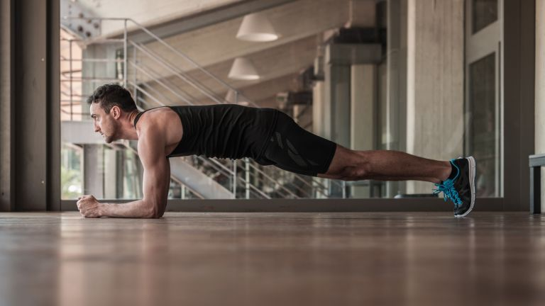 Man doing a plank, one of the best workouts for abs