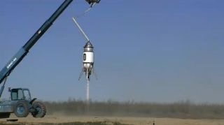 The suborbital Xaero launch vehicle built by Masten Space Systems performs a tethered flight test on Feb. 21, 2011 in this still from a video by Masten officials.