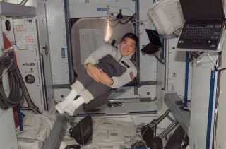 Station Astronaut Draws Support From Earth After Family Loss