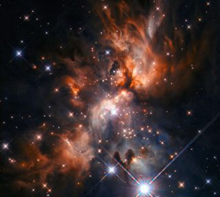 """NASA's Hubble Space Telescope caught a glimpse of a """"stellar nursery"""" — a cloud of dust where stars are born."""