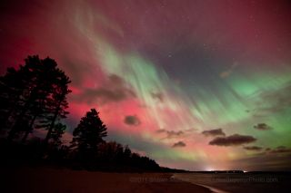 This spectacular photo of red, pink and green auroras on Oct. 24, 2011 was taken by photographer Shawn Malone of Marquette, Michigan, from the shore of Lake Superior