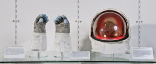 The Smithsonian is displaying Neil Armstrong's gloves and visor to mark the Apollo 11 moonwalkers death.
