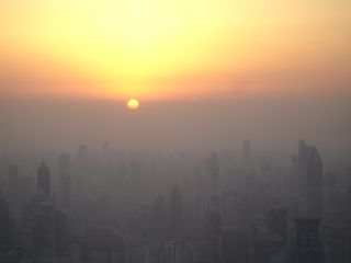 Sunset in Shanghai, smog line, pollution