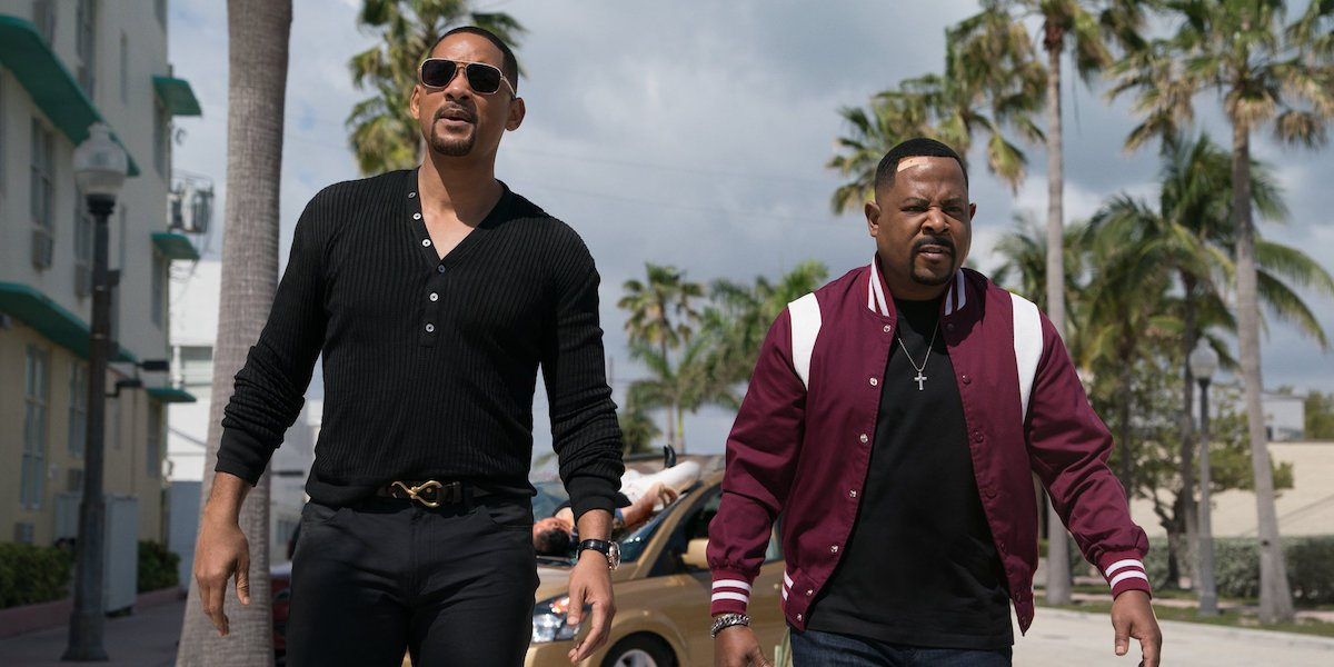 Mike Lowrey (Will Smith) and Marcus Burnett (Martin Lawrence) walk outside in a scene from Bad Boys