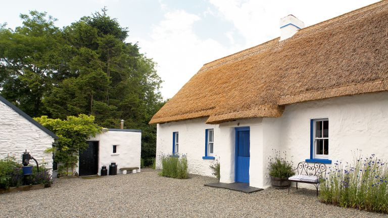 lime washed irish cottage exterior