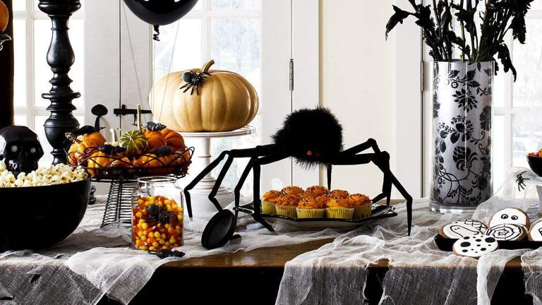 Amazon Prime Day halloween decoration ideas: tablescape with various Halloween decorations, pumpkins, spiders