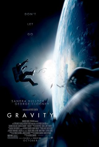 "First official movie poster for director Alfonso Cuarón's ""Gravity"" starring George Clooney and Sandra Bullock."
