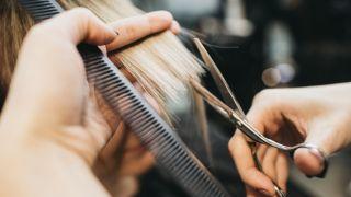 woman giving haircut