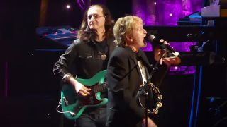 Geddy Lee onstage with Jon Anderson