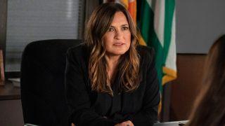 Mariska Hargitay sits at a desk in Law and Order: SVU season 23 on NBC