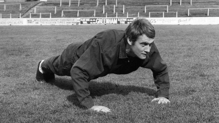 Rodney marsh doing push-ups in the 1960s