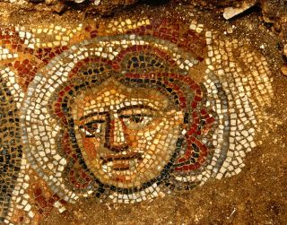 Mosaic face in synagogue.