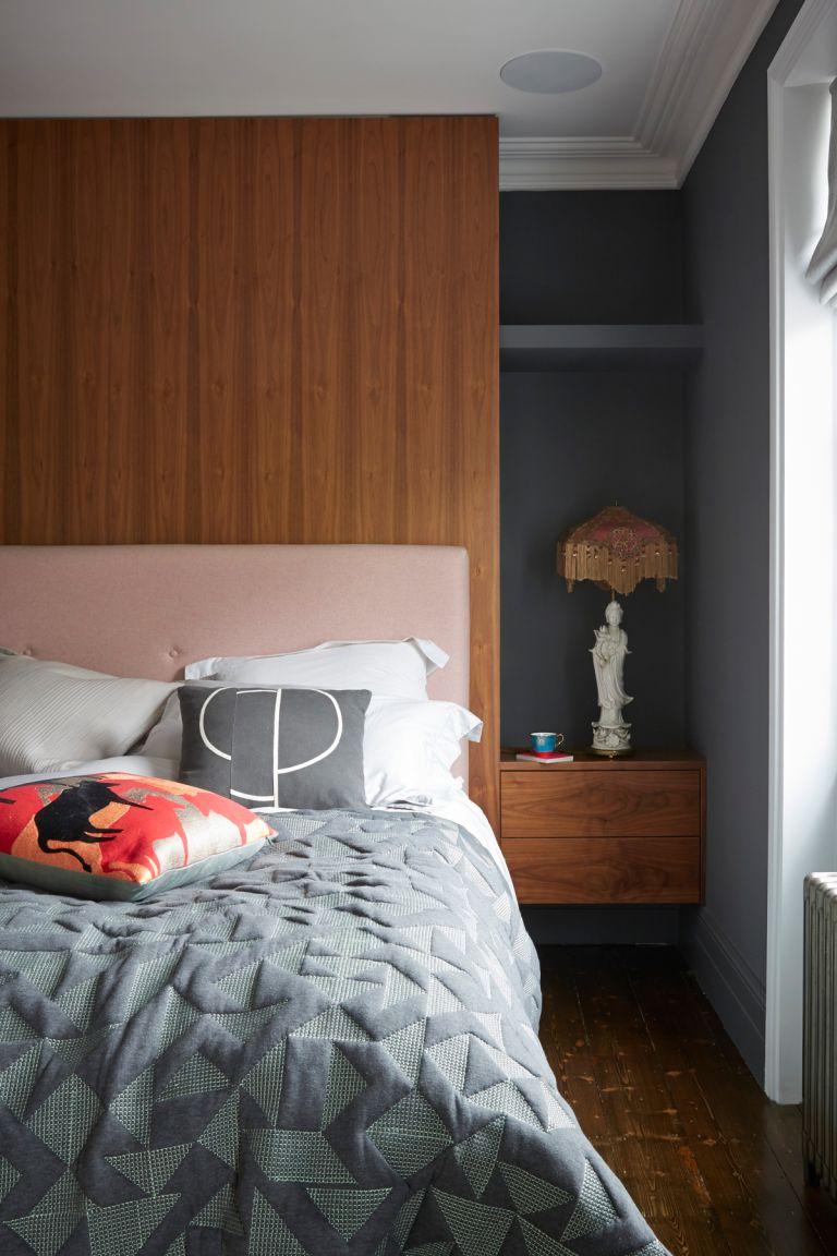 Grey bedroom with wooden headboard
