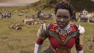 Lupita Nyong'o as Nakia in Dora Milaje outfit in Wakanda in Black Panther