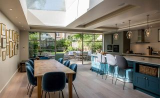 Open plan kitchen-diner leading to garden