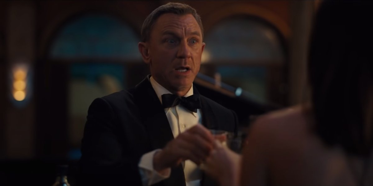 Daniel Craig makes an anxious toast in No Time To Die.
