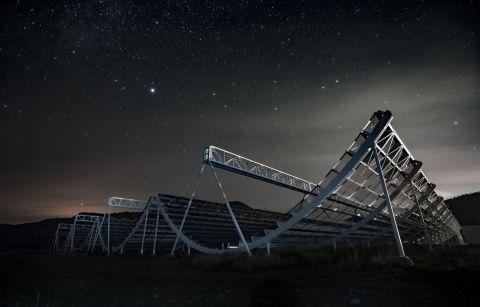 The CHIME radio telescope at night.