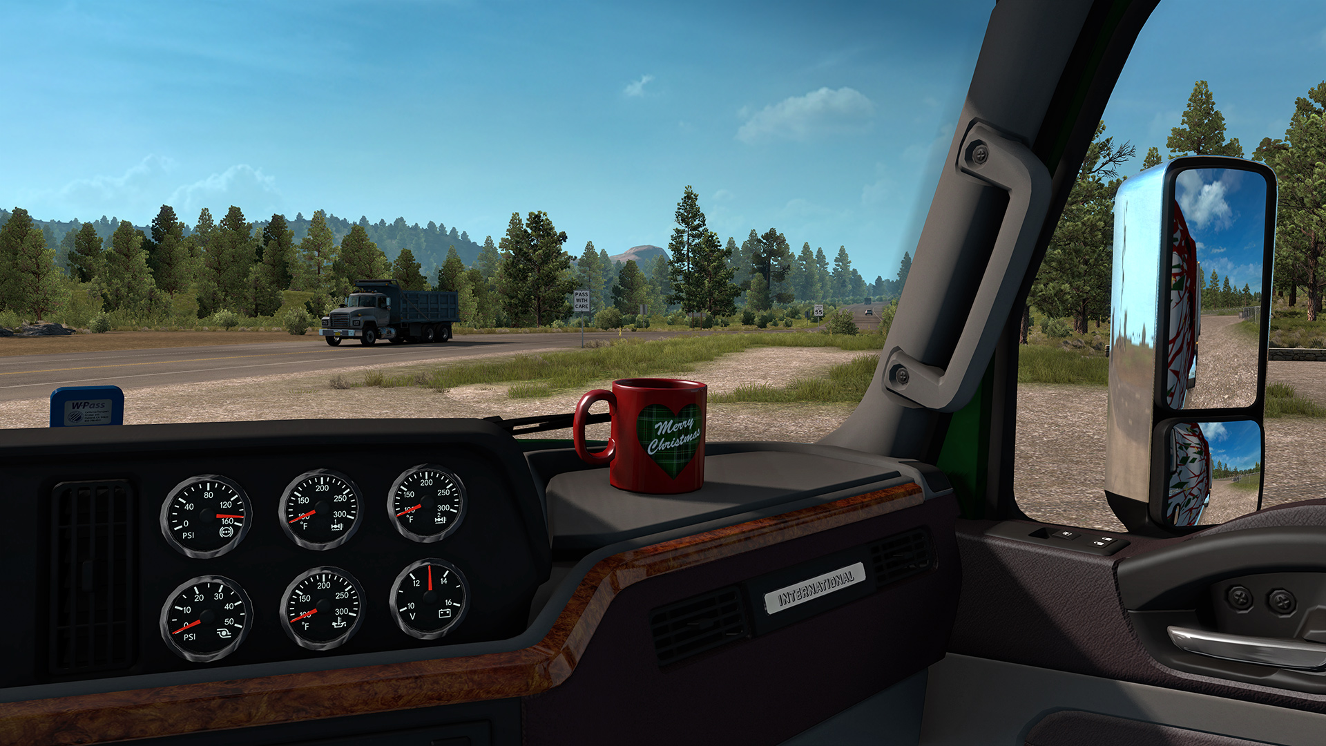 A Christmas-themed mug resting on the dashboard of a truck cab in Euro Truck Simulator 2.