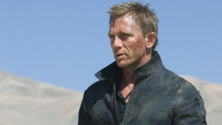 Daniel Craig standing in the desert, looking banged up, in Quantum of Solace.