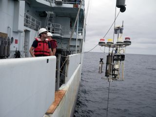 A McLane pump being deployed from R/V Thompson during the West Pacific GEOTRACES cruise in 2013 helped researchers gather small particles of organic matter to which mercury attaches and sinks to intermediate depths (100 to 1,000 meters) in the ocean.